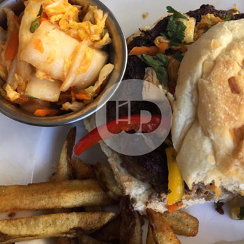 Burger with bread and fries. Side of Kimchi